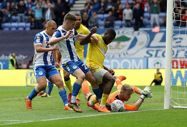 """Soccer Football - League One - Wigan Athletic v AFC Wimbledon - DW Stadium, Wigan, Britain - April 28, 2018 Wigan Athletic's Ryan Colclough in action with AFC Wimbledon's Adedeji Oshilaja and George Long Action Images/John Clifton EDITORIAL USE ONLY. No use with unauthorized audio, video, data, fixture lists, club/league logos or """"live"""" services. Online in-match use limited to 75 images, no video emulation. No use in betting, games or single club/league/player publications. Please contact your account representative for further details."""