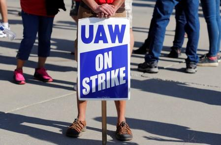 """A """"UAW On Strike"""" sign is seen during a rally outside the shuttered GM Lordstown Assembly plant during the United Auto Workers national strike in Lordstown, Ohio"""