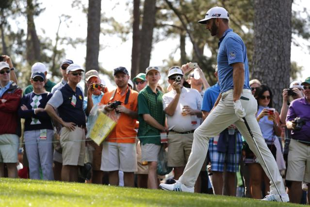 Dustin Johnson of the U.S. walks up the third fairway during practice for the 2018 Masters golf tournament at Augusta National Golf Club in Augusta, Georgia, U.S. April 2, 2018. REUTERS/Jonathan Ernst