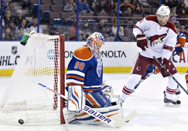 Phoenix Coyotes' Martin Hanzal (11) is stopped by Edmonton Oilers goalie Ilya Bryzgalov (80) during the first period of an NHL hockey game Friday, Jan. 24, 2014, in Edmonton, Alberta. (AP Photo/The Canadian Press, Jason Franson)