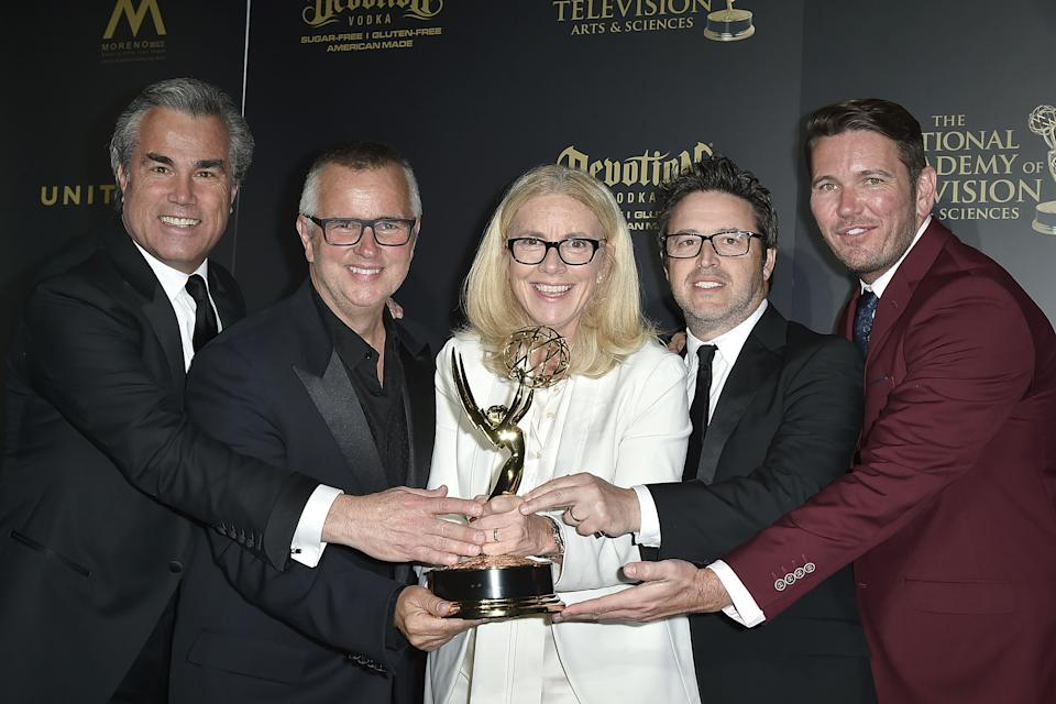 Ellen DeGeneres Show producers post with their Emmy