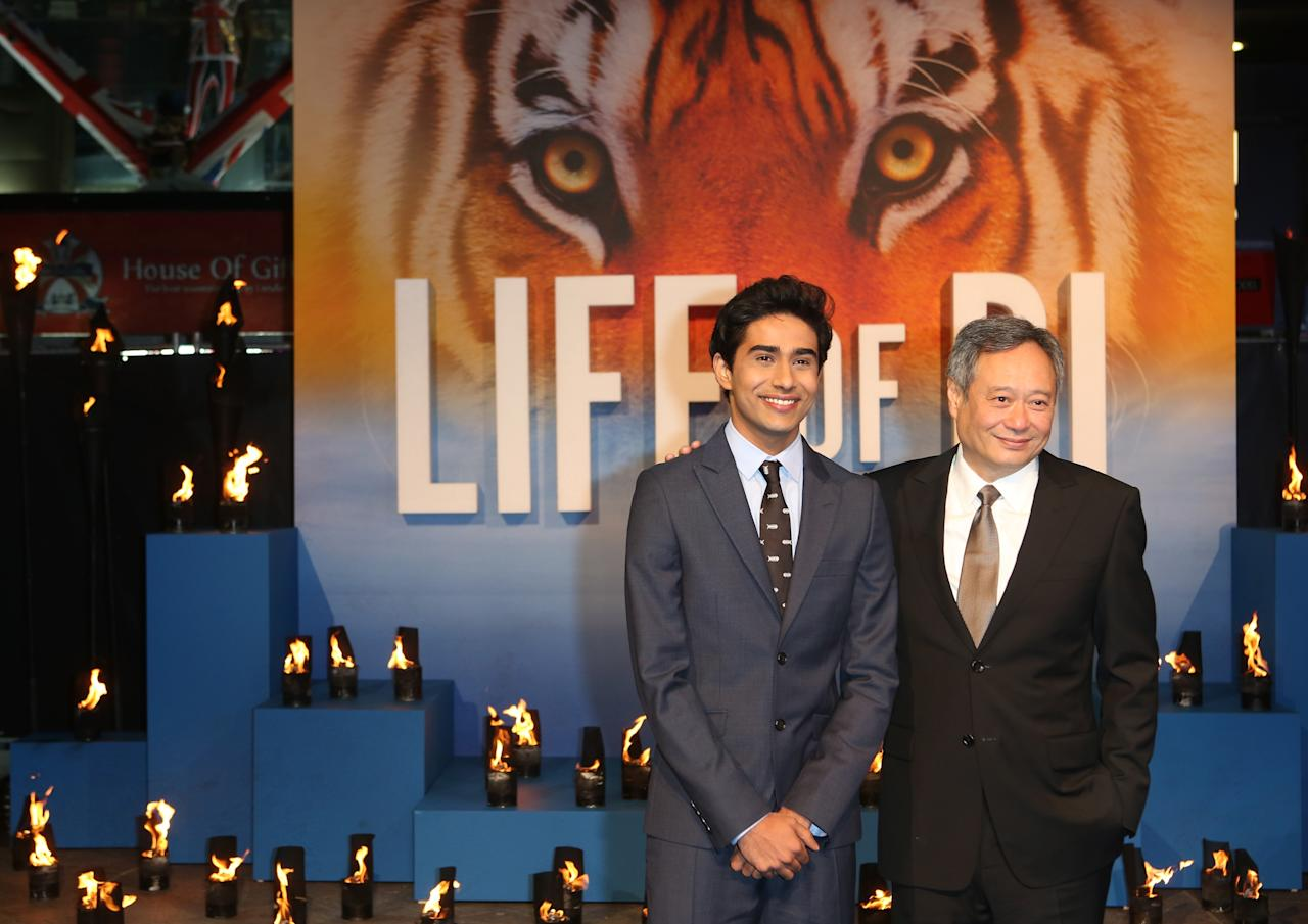 LONDON, ENGLAND - DECEMBER 03:  Actor Suraj Sharma and director Ang Lee attend the UK Premiere of 'Life of Pi at Empire Leicester Square on December 3, 2012 in London, England.  (Photo by Tim Whitby/Getty Images)