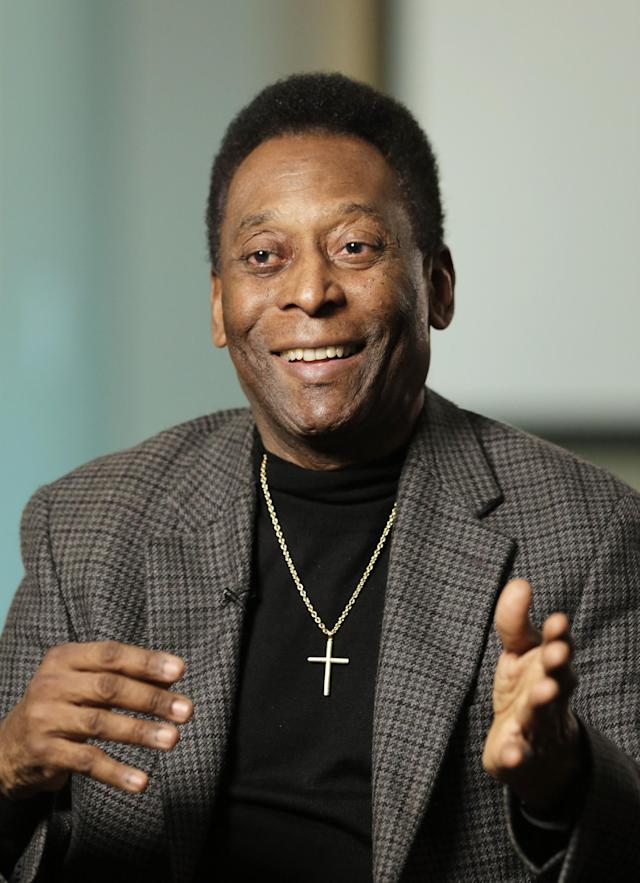 """In this Wednesday, April 2, 2014 photo, Edson Arantes do Nascimento, better known as Pele, is interviewed at The Associated Press in New York. As soccer's showcase returns to the land of """"jogo bonito"""" (the beautiful game), Pele's views are sought. He even has a new book, """"Pele: Why Soccer Matters,"""" which was released this week by Celebra. (AP Photo/Mark Lennihan)"""