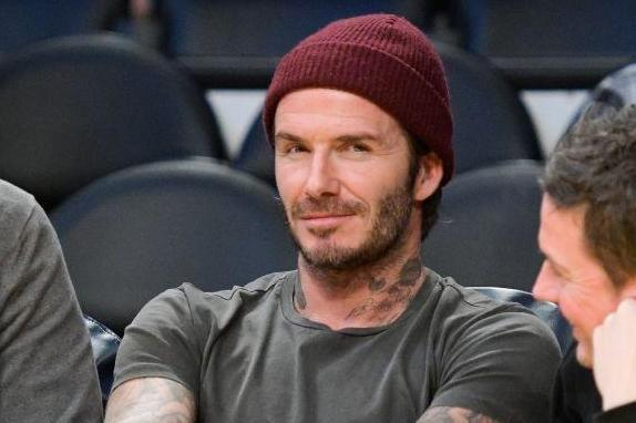 New look: David Beckham has shared a photo of himself on the King Arthur set: Getty Images