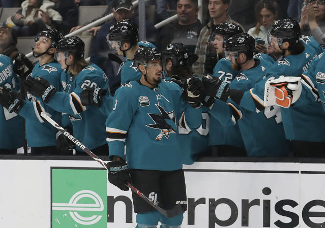 San Jose Sharks left wing Evander Kane (9) is congratulated by teammates after scoring against the Edmonton Oilers during the second period of an NHL hockey game in San Jose, Calif., Tuesday, Jan. 8, 2019. (AP Photo/Jeff Chiu)