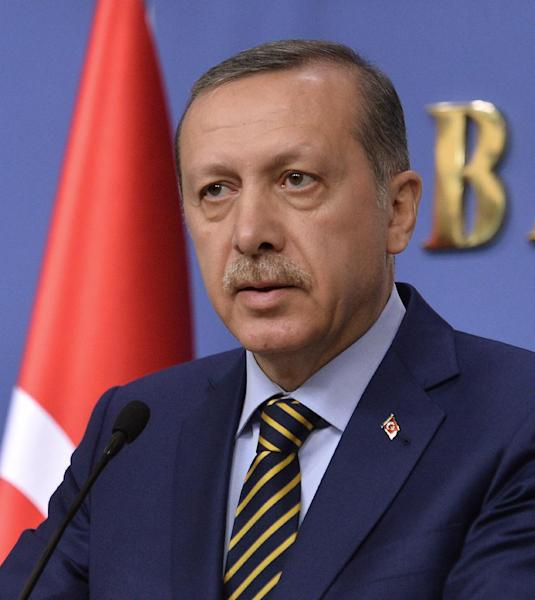 In this photo taken late Wednesday, Dec. 25, 2013, Turkey's Prime Minister Recep Tayyip Erdogan speaks during a news conference in Ankara, Turkey. After a decade of dominance over Turkey's political scene, a rapidly developing corruption and bribery scandal has for the first time left Erdogan looking off balance and not in control of the political reins.(AP Photo/ File)