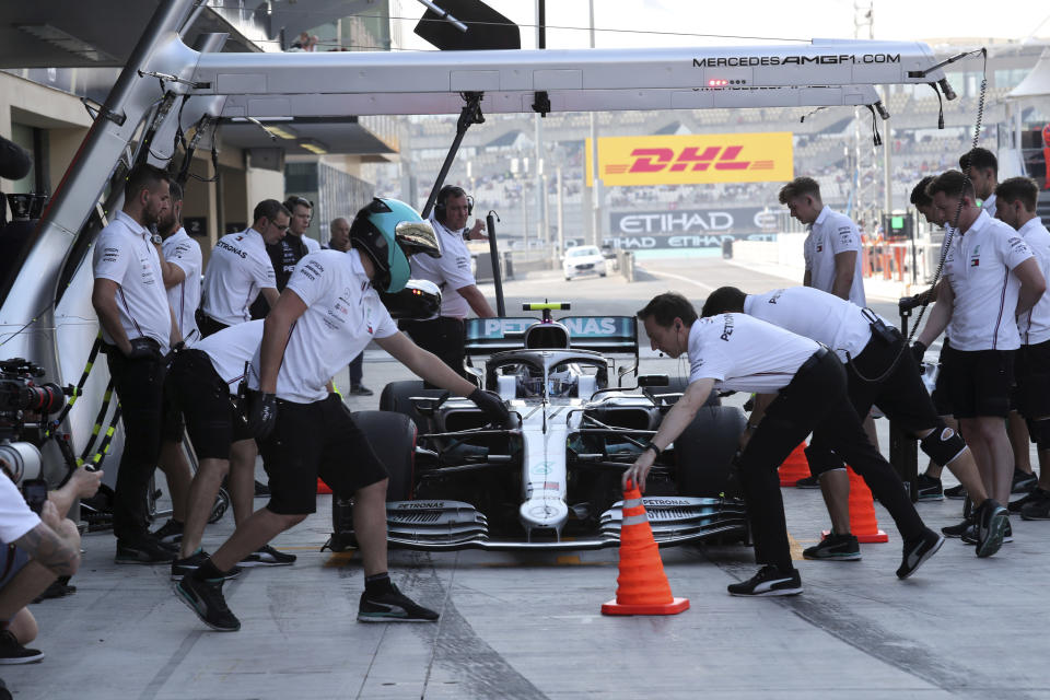 Mercedes driver Valtteri Bottas of Finland gets a pit service during the third free practice at the Yas Marina racetrack in Abu Dhabi, United Arab Emirates, Saturday, Nov. 30, 2019. The Emirates Formula One Grand Prix will take place on Sunday. (AP Photo/Kamran Jebreili)