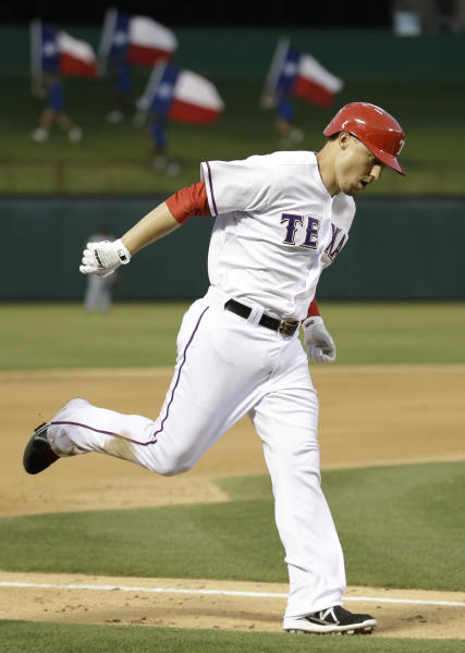Texas Rangers Jeff Baker rounds the bases after hitting a two-run homer during the fourth inning of a baseball game against the Cleveland Indians Monday, June 10, 2013, in Arlington, Texas. (AP Photo/LM Otero)