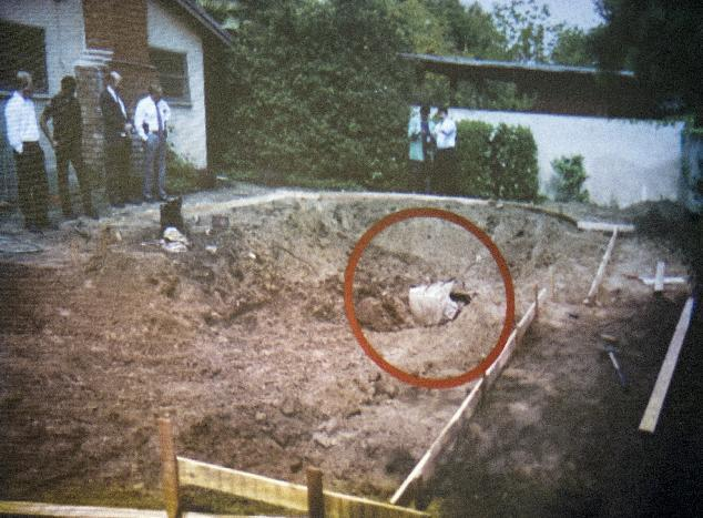 A photo of swimming pool area being unearthed 1994 and finding the remains of John Sohus in the backyard of a home on Loraine Road in San Marino is shown during final arguments by prosecutor Habib Balian in the murder trial of Christian Karl Gerhartsreiter, at Clara Shortridge Foltz Criminal Justice Center in Los Angeles Tuesday, April 9, 2013.  Gerhartsreiter  has pleaded not guilty to the killing of John Sohus, 27, who disappeared with his wife, Linda, in 1985 while Gerhartsreiter was a guest cottage tenant at the home of Sohus' mother, where the couple lived. (AP Photo/San Gabriel Valley Tribune, Pool )