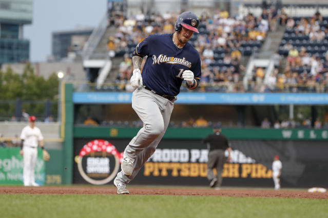 Milwaukee Brewers' Yasmani Grandal rounds the bases after hitting a solo home run during the third inning of the team's baseball game against the Pittsburgh Pirates, Saturday, July 6, 2019, in Pittsburgh. (AP Photo/Keith Srakocic)