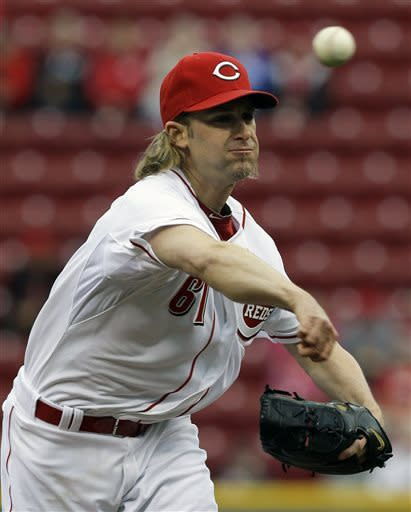 Cincinnati Reds starting pitcher Bronson Arroyo throws against the Atlanta Braves in the first inning of a baseball game, Monday, May 6, 2013, in Cincinnati. (AP Photo/Al Behrman)