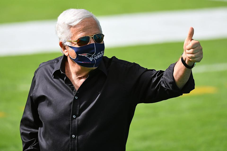Patriots owner Robert Kraft gestures to the fans in attendance prior to the game against the Dolphins at Hard Rock Stadium.
