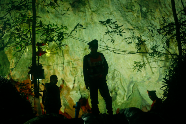 Thai police guard the entrance to the cave. (Photo: PA)