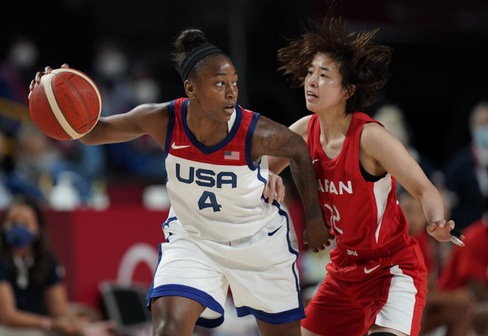 United States' Jewell Loyd (4), left, drives past Japan's Naho Miyoshi (12) during women's basketball preliminary round game at the 2020 Summer Olympics, Friday, July 30, 2021, in Saitama, Japan. (AP Photo/Eric Gay)