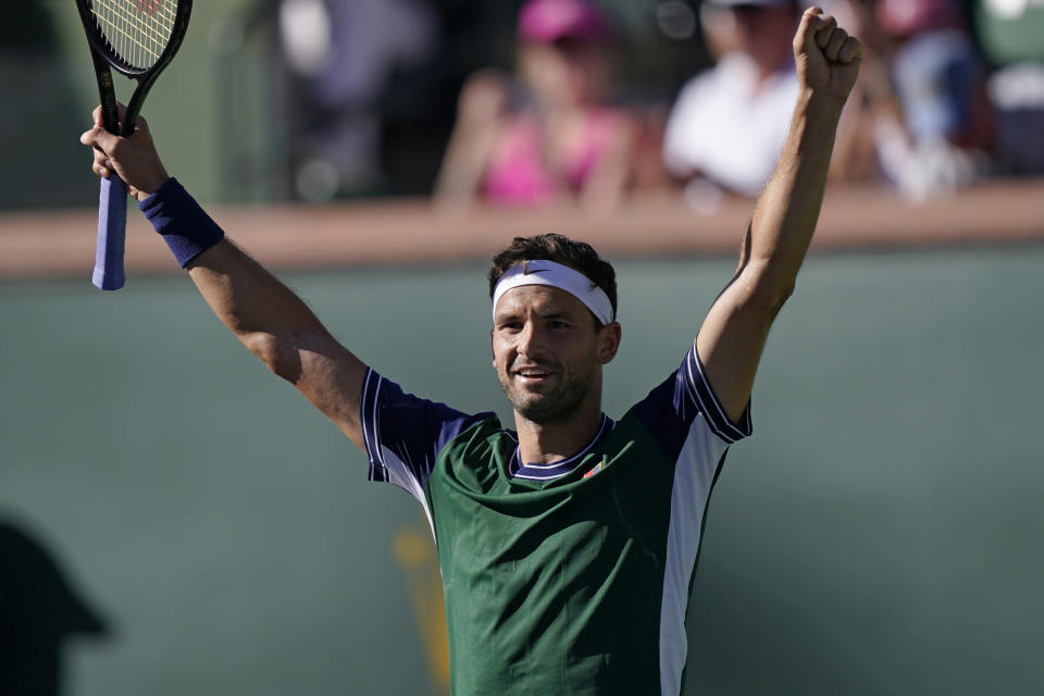 Grigor Dimitrov, of Bulgaria, celebrates after defeating Daniil Medvedev, of Russia, at the BNP Paribas Open tennis tournament Wednesday, Oct. 13, 2021, in Indian Wells, Calif. (AP Photo/Mark J. Terrill)