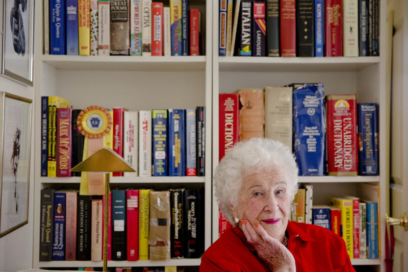Longtime crossword constructor Bernice Gordon born on Jan. 11, 1914, poses for a portrait with her dictionaries at her home, Tuesday, Dec. 31, 2013, in Philadelphia. The New York Times is scheduled publish one of her puzzles, making her the first centenarian ever to have a grid printed in the paper. Gordon's feat comes not long after the centennial of the puzzle itself. (AP Photo/Matt Rourke)