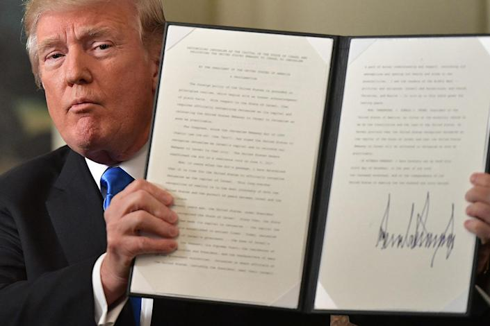 """<p>DEC. 6, 2017 – President Donald Trump holds up a signed proclamation after he delivered a statement on Jerusalem from the Diplomatic Reception Room of the White House in Washington, DC.<br> President Donald Trump recognized the disputed city of Jerusalem as Israel's capital — a historic decision that overturns decades of US policy and risks triggering a fresh spasm of violence in the Middle East.""""I have determined that it is time to officially recognize Jerusalem as the capital of Israel,"""" Trump said from the White House.""""It's the right thing to do."""" (Photo: Mandel Ngan/AFP/Getty Images) </p>"""