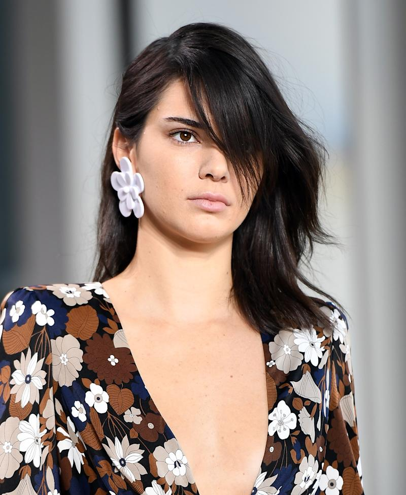Staying true to her au natural style, Jenner debuts her newest do with a bare face on the runway of the Michael Kors Spring 2017 show.