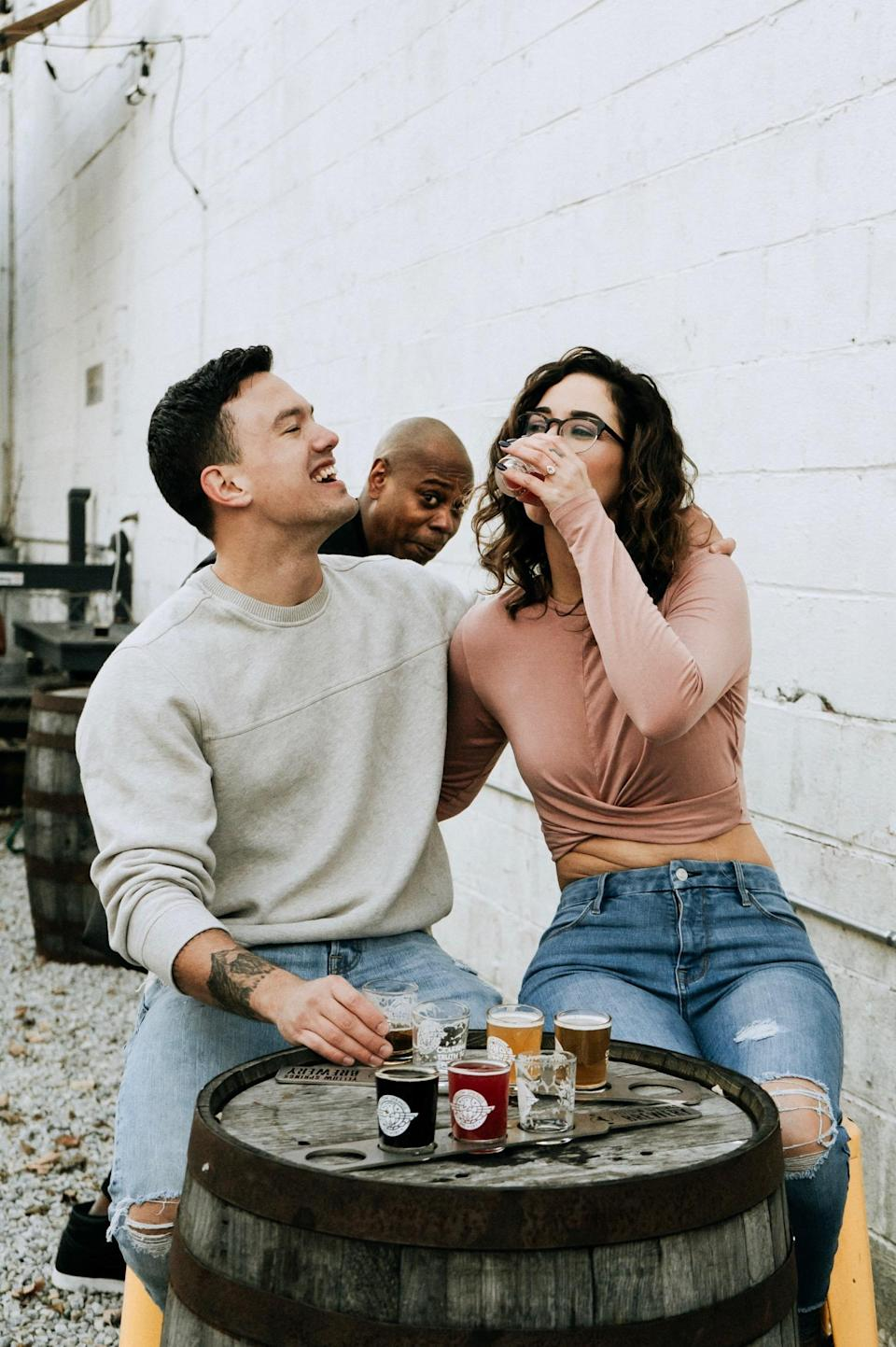 Newly engaged couple Thomas Saunders and Emily Eldridge, with a special appearance by Dave Chappelle. (Photo: Jaycee Marie Photography)