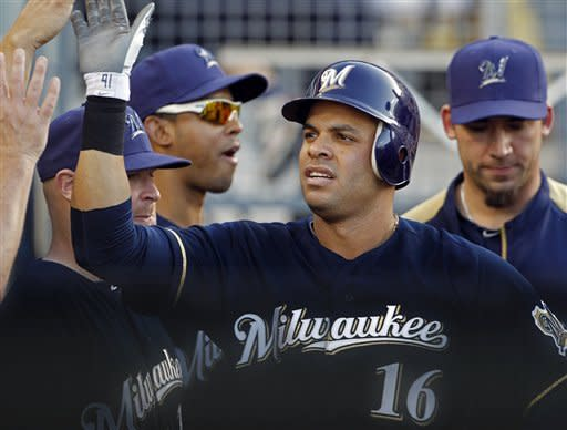 Milwaukee Brewers' Aramis Ramirez is congratulated by teammates on his solo home run against the Los Angeles Dodgers in the fourth inning of a baseball game in Los Angeles Monday, May 28, 2012.(AP Photo/Reed Saxon)