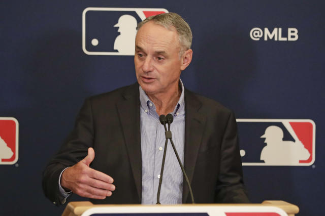Rob Manfred is dealing with a lot right now. (AP Photo/John Raoux)