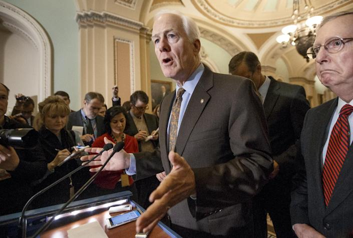 Senate Majority Whip John Cornyn of Texas, accompanied by Senate Majority Leader Mitch McConnell of Ky., right, talks with reporters on Capitol Hill in Washington, Tuesday, Feb. 24, 2015, following a GOP policy meeting.  (J. Scott Applewhite/AP Photo)