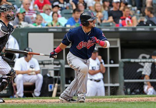 Cleveland Indians' Nick Swisher runs after hitting an RBI-single in the eighth inning that drives in the fourth run as the Indians beat the Chicago White Sox 4-3 in a baseball game in Chicago, Saturday, June 29, 2013. (AP Photo/Charles Cherney)