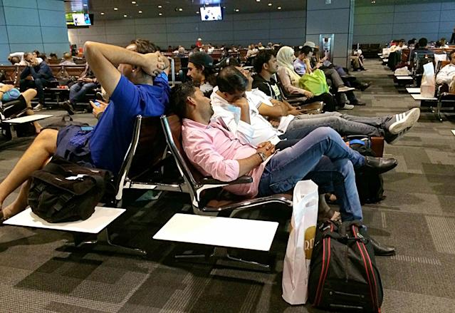 <p>Passengers of cancelled flights wait in Hamad International Airport (HIA) in Doha, Qatar, Tuesday, June 6, 2017. (AP Photo/Hadi Mizban) </p>