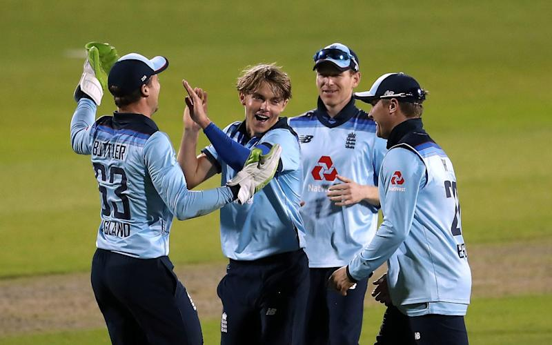 Sam Curran celebrating taking the wicket of Mitchell Starc - PA