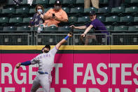 Texas Rangers right fielder Joey Gallo and a fan compete for the home run ball of Seattle Mariners' Kyle Seager in the fifth inning of a baseball game Sunday, May 30, 2021, in Seattle. (AP Photo/Elaine Thompson)