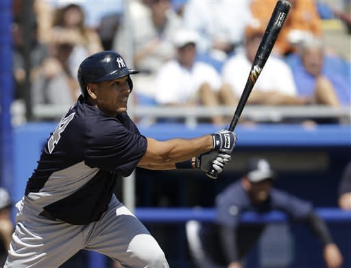 New York Yankees' Juan Rivera hits a fifth-inning three-run double off Toronto Blue Jays pitcher Brett Cecil in a spring training baseball game at Steinbrenner Field in Dunedin, Fla., Sunday, March 10, 2013. (AP Photo/Kathy Willens)
