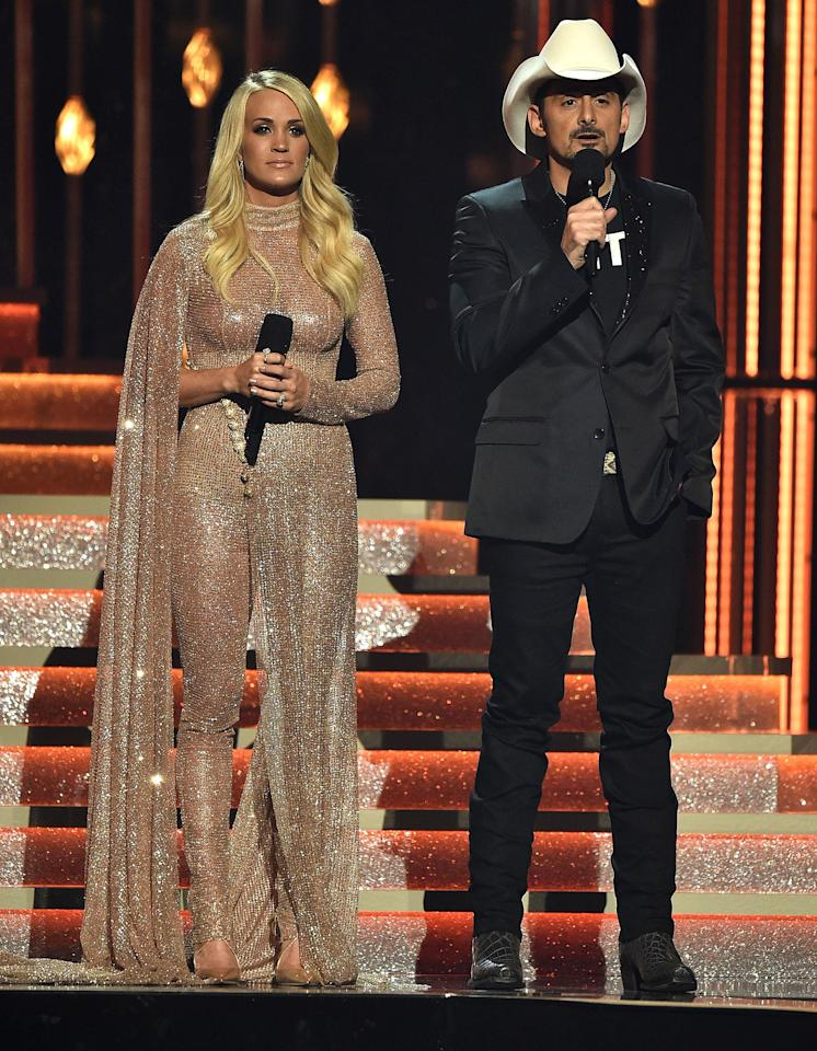 "Though they mocked the president and a host of other political figures in their traditional monologue, it was the stars' tributes to the victims of the Route 91 Harvest Festival shooting (and several other mass shootings that occured that fall) that were most touching.  <a href=""https://people.com/country/cma-awards-2017-carrie-underwood-in-memorium-las-vegas-shooting/"">Underwood tearfully gave</a> the ""in memoriam"" performance, which ended with all 58 of the Route 91 victims' faces. And following the show's opening — a rendition of ""Amazing Grace"" performed by Eric Church, followed by Darius Rucker and a slew of stars singing Hootie & the Blowfish's ""Hold My Hand"" — <a href=""https://people.com/country/cmas-2017-brad-paisley-awards-pay-respects-las-vegas-shooting/"">Paisley dedicated the show</a> ""to all those lost and all those still healing. We love you and we will never forget you."""