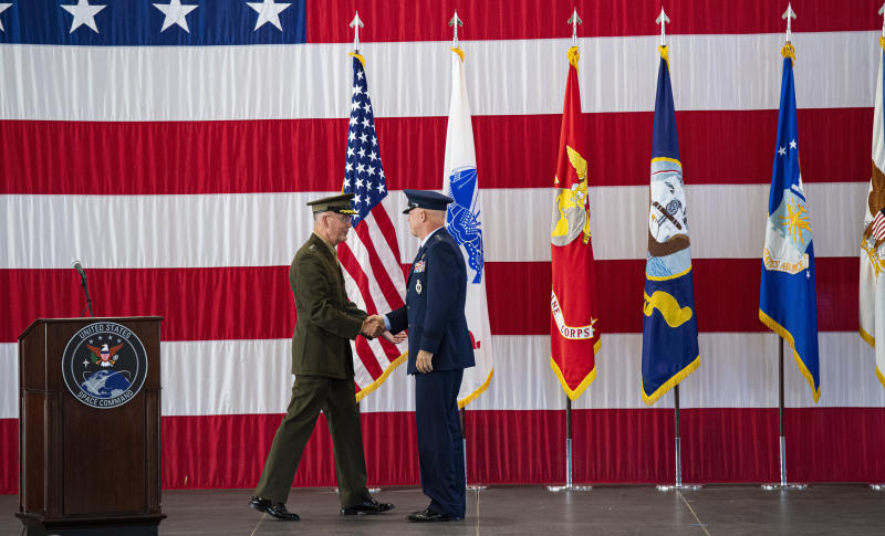 Joint Chiefs of Staff Gen. Joseph F. Dunford, Jr., left, shakes hands with Gen. John W. Raymond, the commander of the U.S. Space Command, Sept. 9, 2019, during a ceremony to recognize the establishment of the United States Space Command at Peterson Air Force Base in Colorado Springs, Colo.  (Christian Murdock/The Gazette via AP)