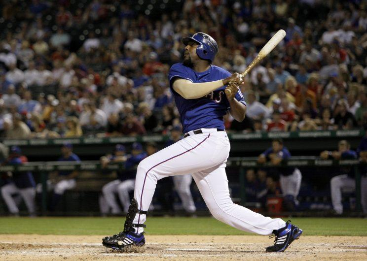 Texas Rangers' Vladimir Guerrero, right, looks on after hitting a two-run home run off of Kansas City Royals' Josh Rupe in the sixth inning of a baseball game, Thursday, May 6, 2010, in Arlington, Texas. The shot was the first of two home runs for Guerrero in the 13-12 Rangers win. (AP Photo/Tony Gutierrez)