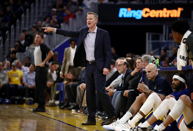 Though he's been limited to eight players repeatedly and won just three games, Golden State Warriors coach Steve Kerr is keeping his head up this season. (Ezra Shaw/Getty Images)