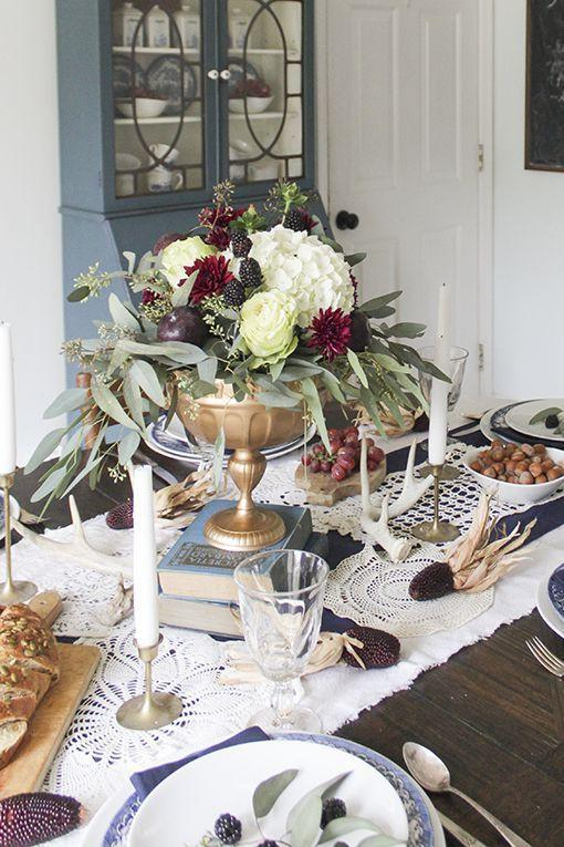 """<p>There's no need to pay top dollar for a memorable centerpiece. In this pretty vignette, vintage books are used to lift a single floral arrangement. The books, like the rest of the tablescape, are accented in navy, burgundy, and gold.</p><p><strong>Get the tutorial at <a href=""""http://www.shadesofblueinteriors.com/thanksgiving-tablescape-in-navy-burgundy-and-gold/"""" rel=""""nofollow noopener"""" target=""""_blank"""" data-ylk=""""slk:Shades of Blue Interiors"""" class=""""link rapid-noclick-resp"""">Shades of Blue Interiors</a>.</strong></p><p><strong><a class=""""link rapid-noclick-resp"""" href=""""https://www.amazon.com/WaaHome-Decorative-Boxes-Leather-Decorations/dp/B07D36FV57?tag=syn-yahoo-20&ascsubtag=%5Bartid%7C10050.g.2130%5Bsrc%7Cyahoo-us"""" rel=""""nofollow noopener"""" target=""""_blank"""" data-ylk=""""slk:SHOP VINTAGE BOOK DECOR"""">SHOP VINTAGE BOOK DECOR</a><br></strong></p>"""