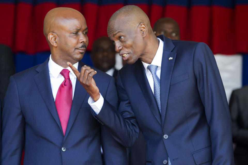 Haiti's President Jovenel Moise, right, talks with resigning prime minister Jean Michel Lapin, at the national palace during a ceremony marking the 216th anniversary of Battle of Vertieres in Port-au-Prince, Haiti, Monday, Nov. 18, 2019. The battle was the last major battle of Haitian independence from France. (AP Photo/Dieu Nalio Chery)