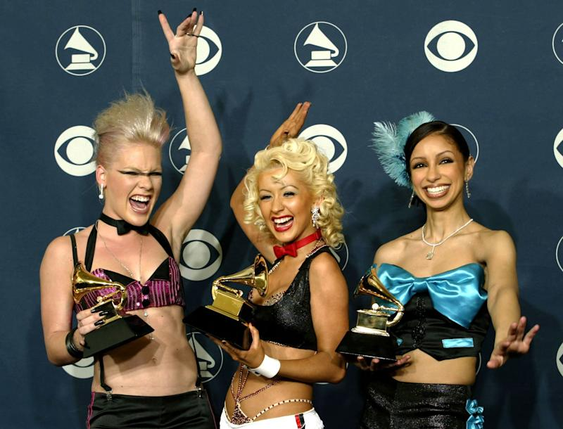 "Pink, Christina Aguilera and Mya pose with the Grammy Award they won for ""Lady Marmalade"" on Feb. 27, 2002."