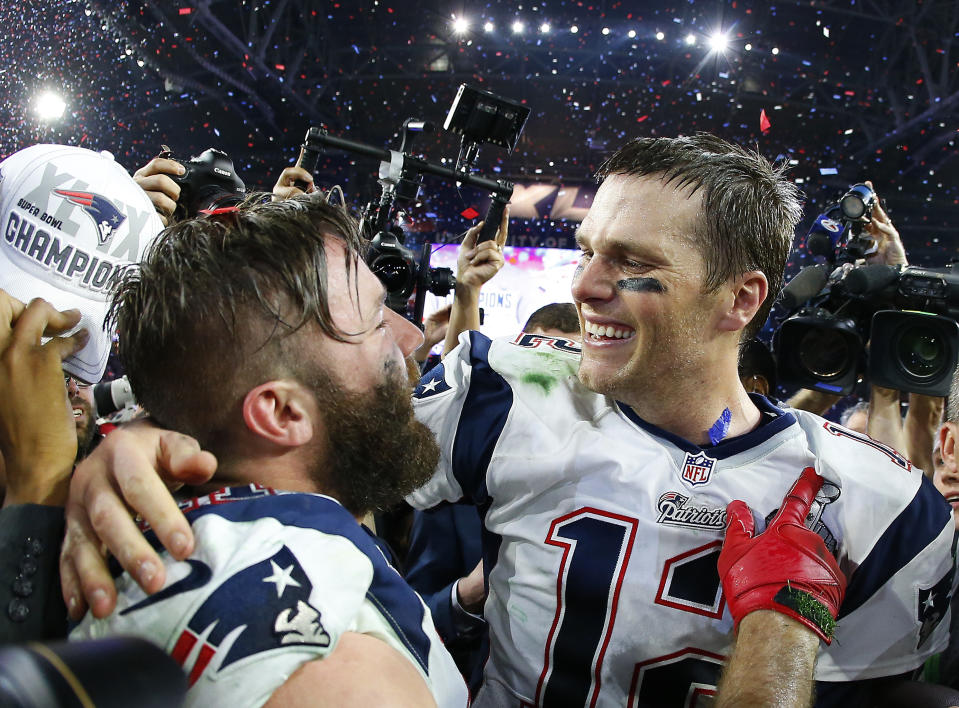 GLENDALE, AZ - FEBRUARY 01:  Tom Brady #12 and  Julian Edelman #11 of the New England Patriots celebrate after defeating the Seattle Seahawks 28-24 to win Super Bowl XLIX at University of Phoenix Stadium on February 1, 2015 in Glendale, Arizona.  (Photo by Tom Pennington/Getty Images)