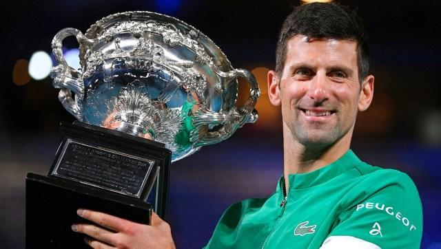 Serbia's Novak Djokovic holds the Norman Brookes Challenge Cup after defeating Russia's Daniil Medvedev in the men's singles final at the Australian Open tennis championship in Melbourne, Australia. AP