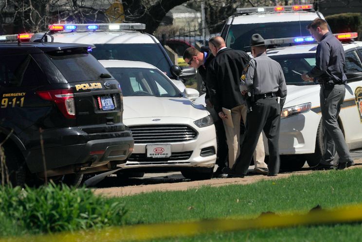 Police investigate the scene after Stephens killed himself in his car (AP)