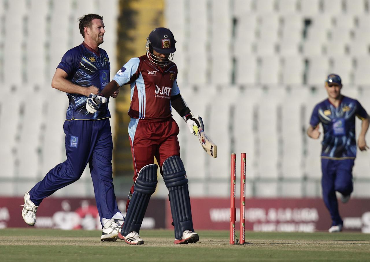 Butler after taking a wicket during the Champions League T20, 3rd Match between Kandurata Maroons and Otago Volts at Mohali stadium, Chandigarh on Sept. 18, 2013. (Photo: IANS)