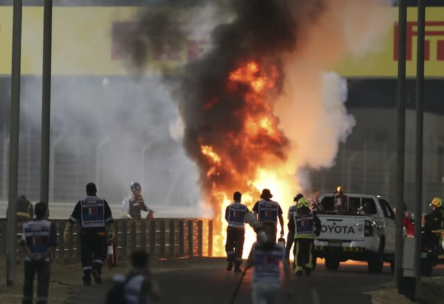 Marshals run to extinguish Romain Grosjean's car