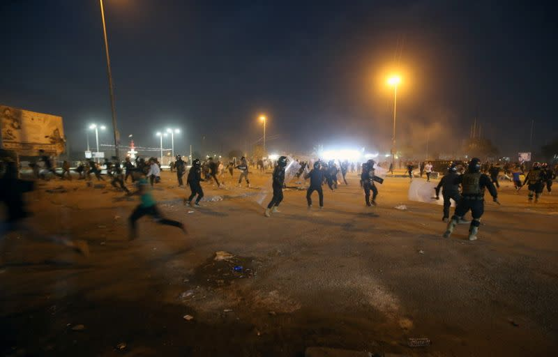 Iraqi demonstrators clash with Iraqi security forces during anti-government protests in Basra