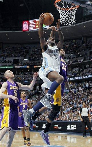 Denver Nuggets guard Ty Lawson, front, slides between Los Angeles Lakers guard Steve Blake, back left, and center Jordan Hill for a basket in the fourth quarter of the Nuggets' 113-96 victory in Game 6 of the teams' first-round NBA basketball series in Denver on Thursday, May 10, 2012. (AP Photo/David Zalubowski)
