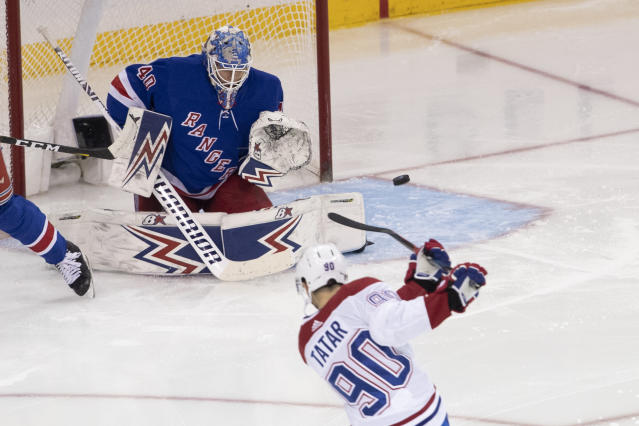 New York Rangers goaltender Alexandar Georgiev (40) makes a save against Montreal Canadiens left wing Tomas Tatar (90) during the third period of an NHL hockey game Friday, Dec. 6, 2019, at Madison Square Garden in New York. The Canadiens won 2-1. (AP Photo/Mary Altaffer)