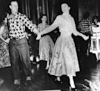 <p>The Duke of Edinburgh and Princess Elizabeth hand-in-hand during a square dance that was held in their honor in Ottowa, Canada by Governor General Viscount Alexander. This dance was one of the events arranged during their Canadian tour in the fall of 1951.</p>