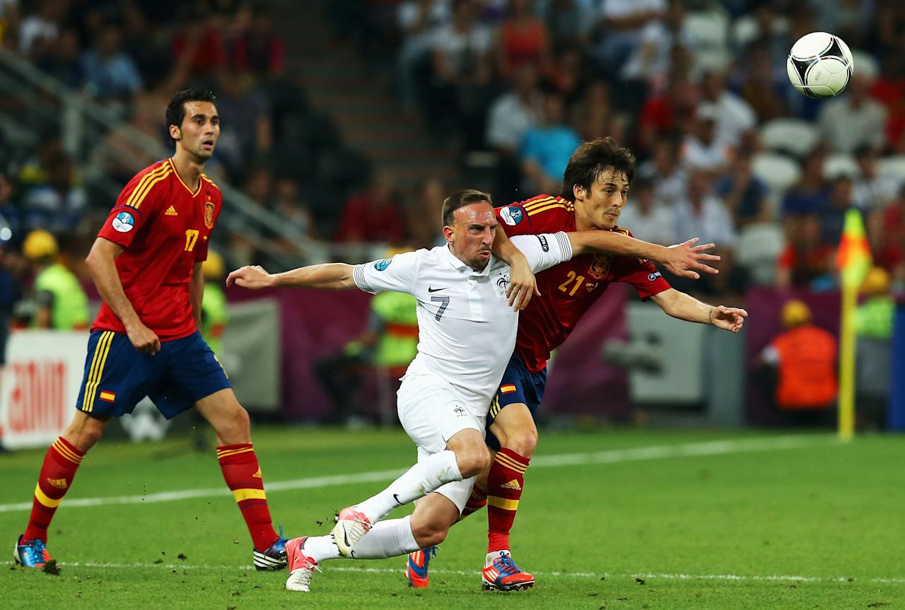 DONETSK, UKRAINE - JUNE 23: Franck Ribery of France and David Silva of Spain challenge for the ball during the UEFA EURO 2012 quarter final match between Spain and France at Donbass Arena on June 23, 2012 in Donetsk, Ukraine.  (Photo by Martin Rose/Getty Images)