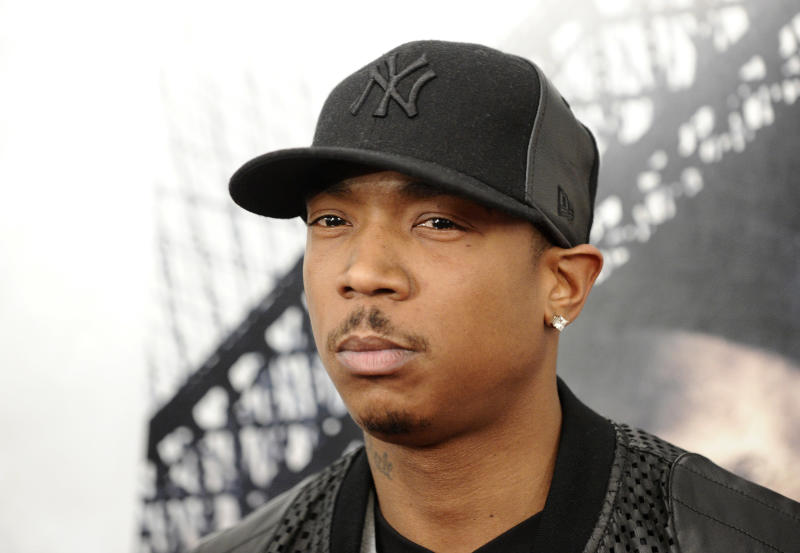 """FILE - In this March 2, 2010 file photo, rapper Ja Rule attends the premiere of """"Brooklyn's Finest"""" in New York. Platinum-selling rapper Ja Rule was set to leave an upstate New York prison on Thursday, Feb. 21, 2013 after serving most of his two-year sentence for illegal gun possession but head straight into federal custody in a tax case. (AP Photo/Peter Kramer, File)"""