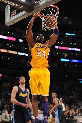 LOS ANGELES, CA - MAY 1: Kobe Bryant #24 of the Los Angeles Lakers dunks against the Denver Nuggets in Game Two of the Western Conference Quarrterfinals during the 2012 NBA Playoffs at Staples Center on May 1, 2012 in Los Angeles, California. (Photo by Noah Graham/NBAE via Getty Images)